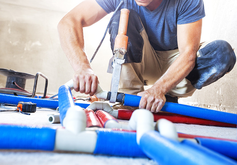 plumber working - Plumbing Costs: Need to Know